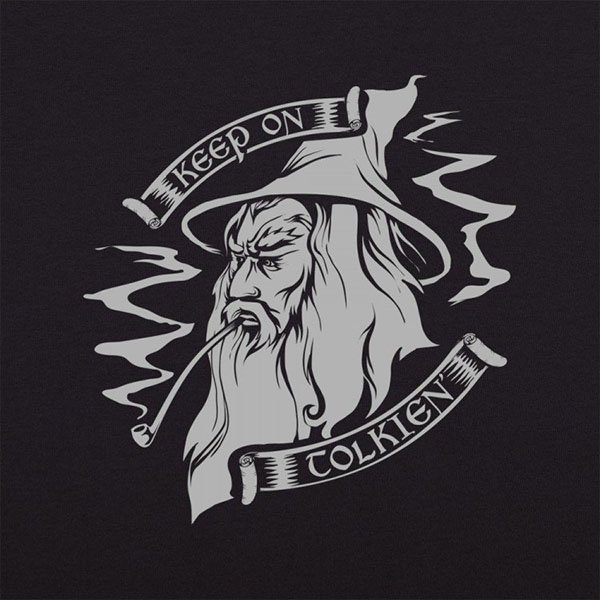 The head of a bearded wizard wearing a pointed hat smoking a pipe and the words Keep On Tolkien